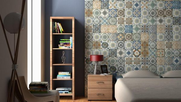 A bedroom with bedroom furniture and Nikea patterned wall tiles on the wall